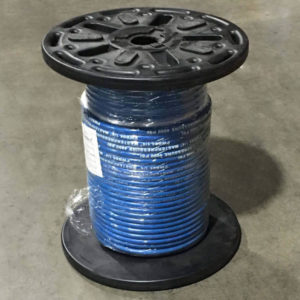 Blue solution cleaner hose on a black reel in the warehouse.
